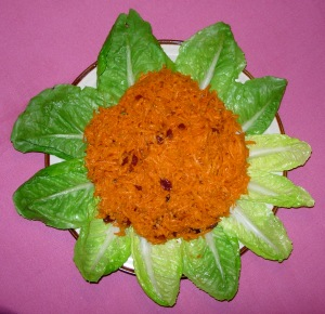 Incan Carrot Salad displayed with romaine leaves